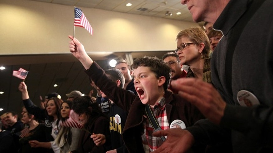 FILE: January 10, 2012. A young supporter of Republican presidential candidate and Libertarian Texas Rep. Ron Paul at a rally in Manchester, New Hampshire.
