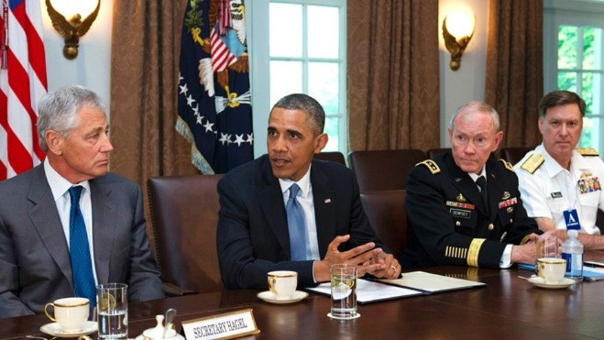 FILE: May 16, 2013: Defense Secretary Chuck Hagel, left, listens to President Obama, next to Joint Chiefs Chairman Gen. Martin Dempsey, and Vice Chief of Naval Operations Adm. Mark Ferguson, in Washington, D.C.