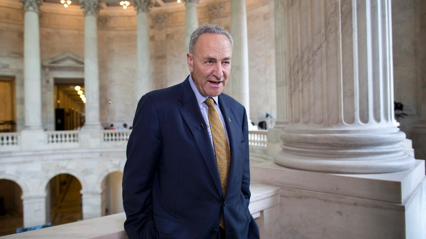 FILE: April 8, 2014: Sen. Chuck Schumer, D-N.Y., talks during a television news interview on Capitol Hill in Washington, D.C.