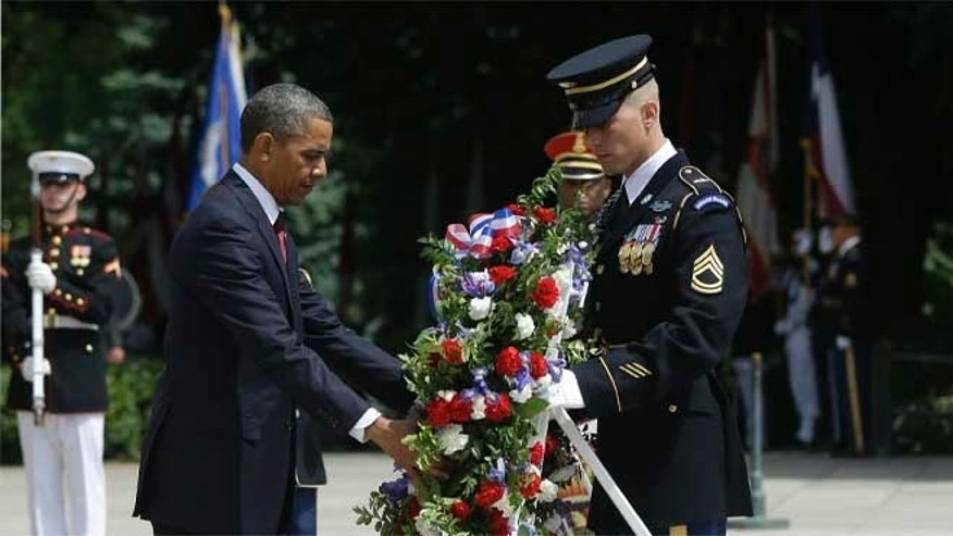 President Obama participates in the wreath-laying ceremony at the Tomb of the Unknowns at Arlington National Cemetery on Memorial Day, May 27, 2013, in Arlington, Va.