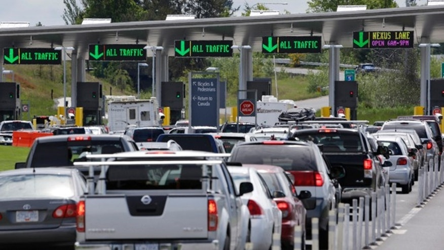 May 23, 2013: Cars from Canada line up to cross into the U.S. in Blaine, Wash. In April 2013, in its 2014 fiscal year budget proposal, the Department of Homeland Security requested permission to study a fee at the nation's land border crossings. The request has sparked wide opposition among members of Congress from northern states, who vowed to stop it. A fee, they say, would hurt communities on the border that rely on people, goods and money moving between the U.S. and Canada.