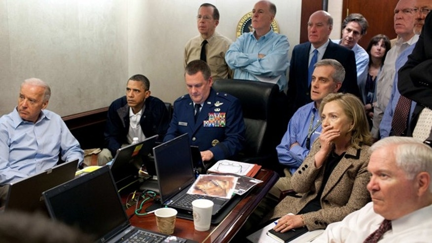 Image released by the White House and digitally altered by the source to obscure the details of a document in front of Secretary of State Hillary Clinton, right with hand covering mouth, President Obama, second from left, Vice President Joe Biden, left, Secretary of Defense Robert Gates, right, and members of the national security team watch an update of the mission against Usama bin Laden.