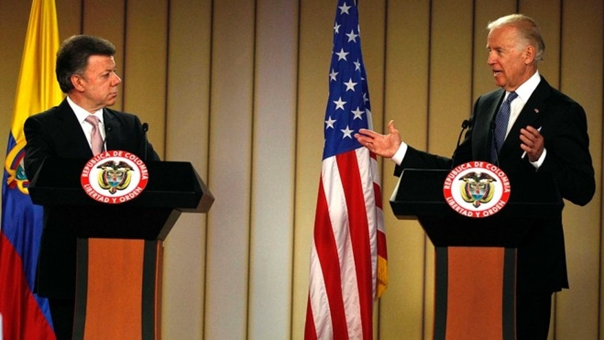 Vice President Joe Biden, right, speaks during a joint press conference with Colombia's President Juan Manuel Santos at the presidential palace in Bogota, Colombia, Monday, May 27, 2013. (AP Photo/Fernando Vergara)