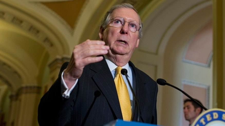 May 21, 2013: Senate Minority Leader Mitch McConnell gestures during a news conference on Capitol Hill.