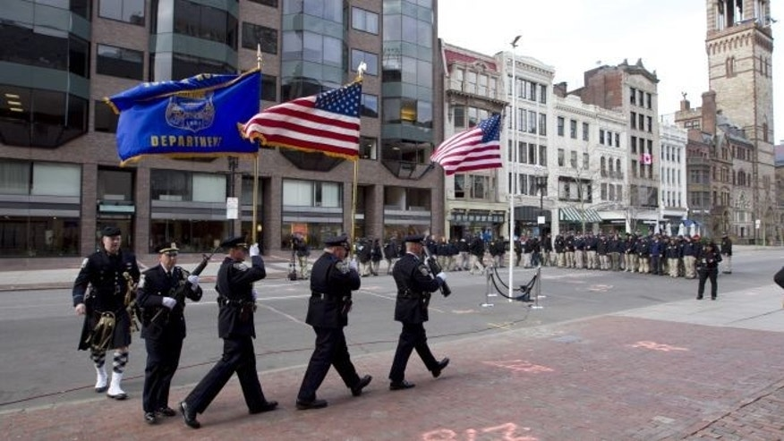 April 22, 2013: Officers march into position near the blast site on Boylston Street between Dartmouth and Exeter Streets near the Boston Marathon finish line in Boston.