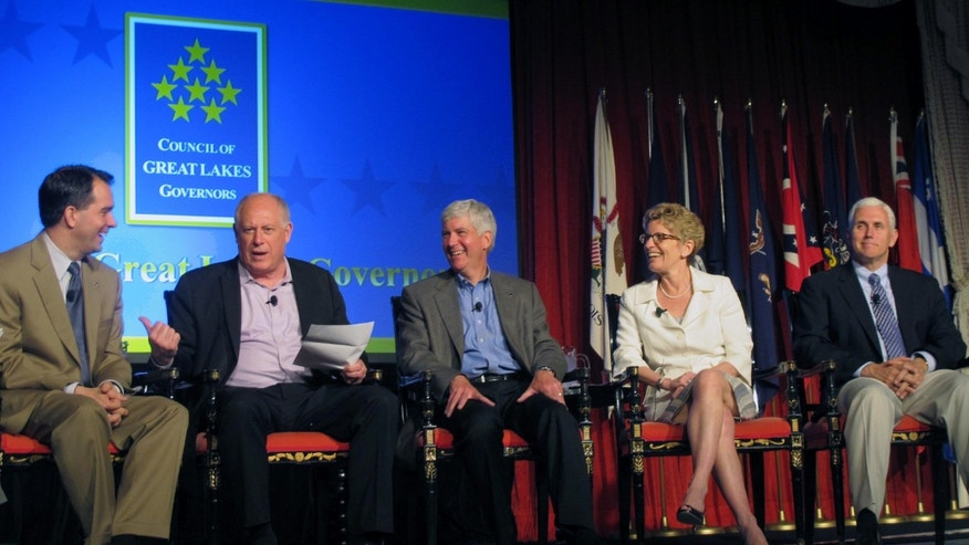 June 1, 2013: Members of the Council of Great Lakes Governors discuss regional policies on trade and water quality on Mackinac Island, Mich. From left: Wisconsin Gov. Scott Walker, Illinois Gov. Pat Quinn, Michigan Gov. Rick Snyder, Ontario Premier Kathleen Wynne, and Indiana Gov. Mike Pence.