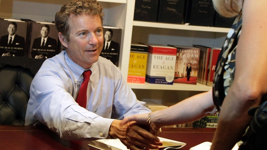 "U.S. Sen. Rand Paul, R-Ky., greets wellwishers as he autographs his book, ""Government Bullies,"" before speaking at the Ronald Reagan Presidential LIbrary in Simi Valley, Calif., Friday, May 31, 2013. (AP Photo/Reed Saxon)"
