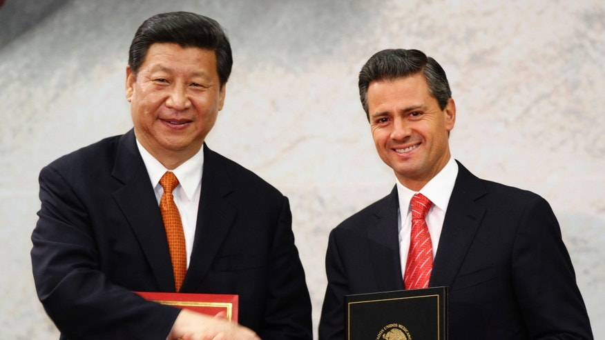 Chinese President Xi Jinping and his Mexican counterpart Enrique Pena Nieto during an agreement signing ceremony at Los Pinos presidential residence in Mexico City.