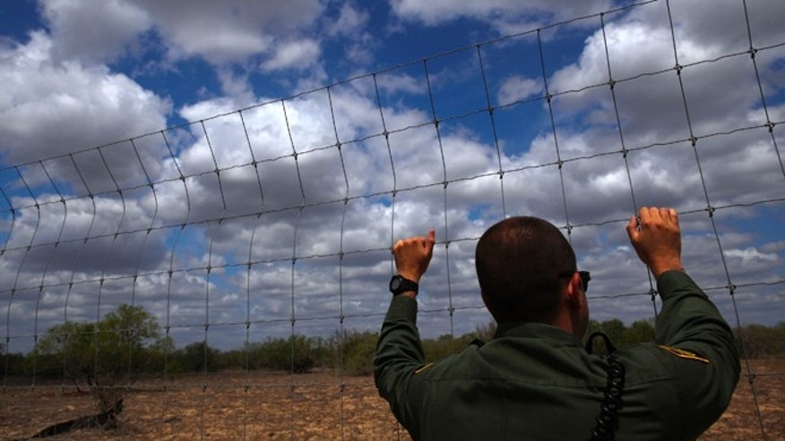 FILE: March 29, 2013: A U.S. Border Patrol agent looks across the desert near Falfurrias, Texas, where the intense heat and rough terrain has killed many people trying to cross illegally from Mexico into the United States.
