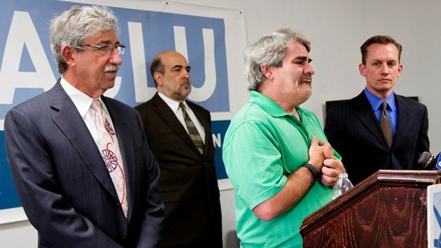 June 12, 2013: Surrounded by attorneys, James Brown, second from right, talks at  a news conference at the ACLU headquarters in Las Vegas, Nevada.