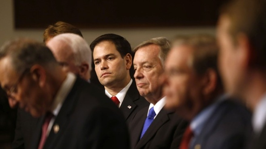 """Senators who are part of the bipartisan """"Gang of Eight"""" hold a news conference about their immigration reform bill."""