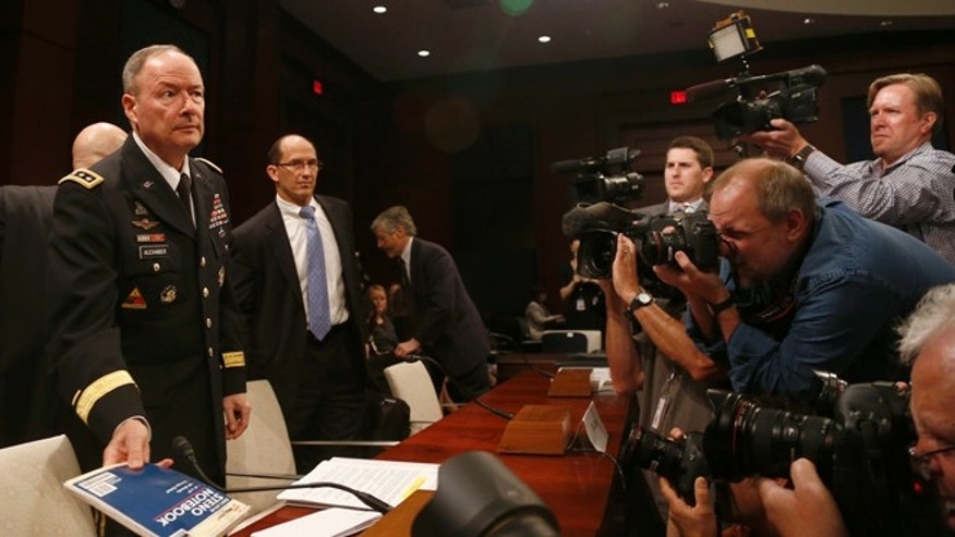 June 18, 2013: From left: National Security Agency Director Gen. Keith B. Alexander; Deputy FBI Director Sean Joyce; and Robert Litt, general counsel to the Office of the Director of National Intelligence arrive on Capitol Hill in Washington.