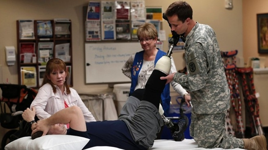 FILE: May 10, 2013: A wounded soldier receives treatment at a rehabilitation center at Walter Reed National Military Medical Center in Bethesda, Md.