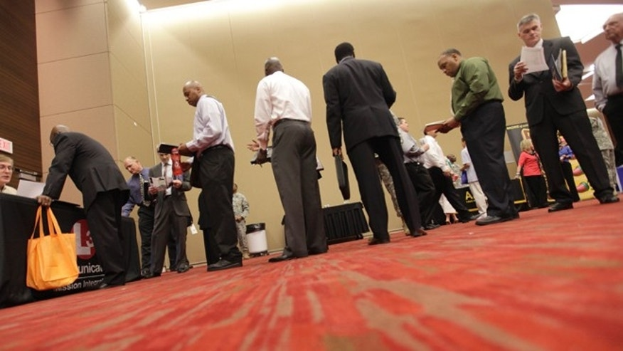 July 19, 2012: Job seekers line up to speak to a recruiter during a job fair in Irving,  Texas.