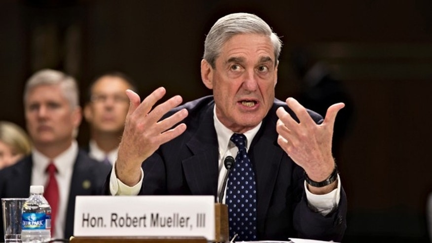 June 19, 2013: FBI Director Robert Mueller testifies on Capitol Hill in Washington.