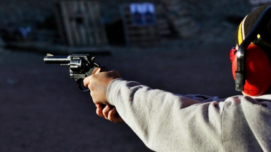 Dec. 23, 2012: A man shoots a revolver, at Dragonman's firing range and gun dealer, outside Colorado Springs, Colo.