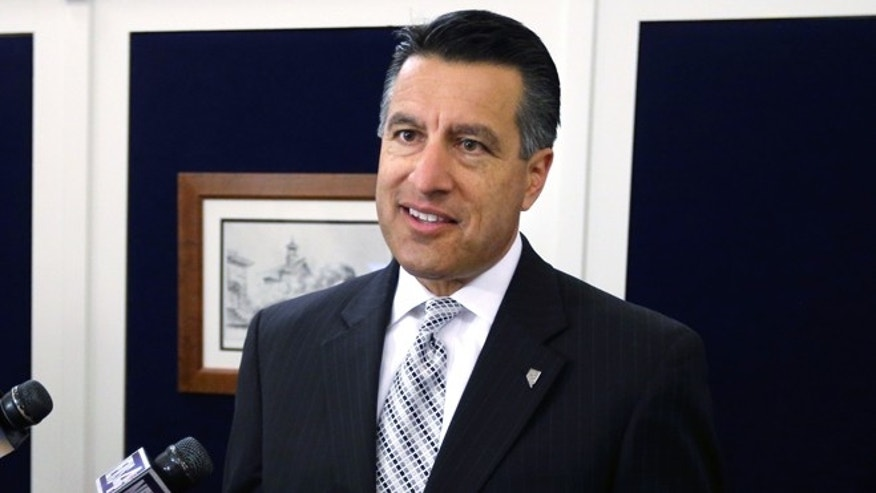 FILE: June 4,2013: Nevada Gov. Brian Sandoval talks following a special Legislative session in Carson City, Nev.
