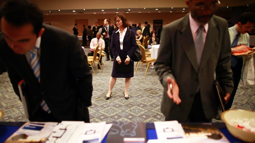 FILE: June 11, 2012: People participate in a job fair in New York. N.Y.