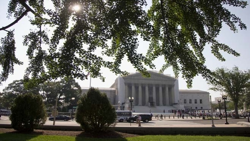 People wait in line outside the Supreme Court in Washington, Monday, June 24, 2013