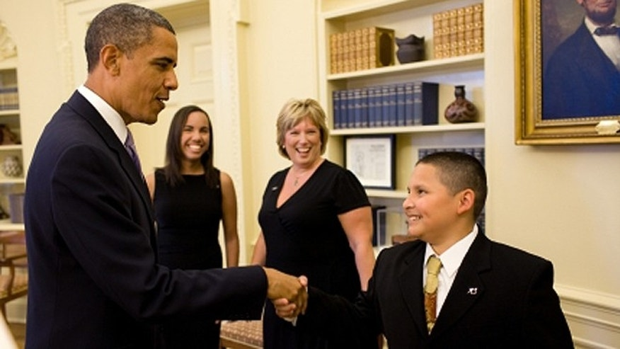 President Obama shakes 2009 little brother Anthony Saldan's hand in July 2010 as Big Sister of the Year Debbie Groulik, of Fort Wayne, Ind., and her little sister, 19-year-old Jocelyn, look on. (WhiteHouse.gov)