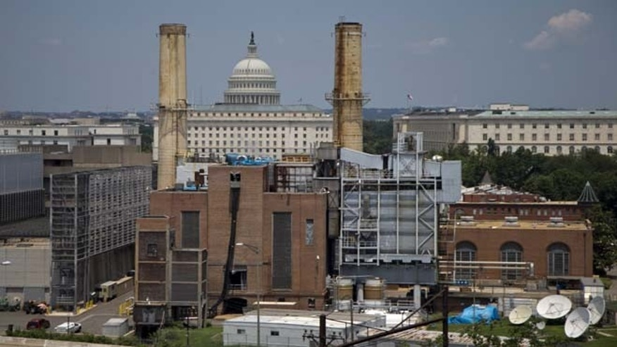 The Capitol Dome is seen behind the Capitol Power Plant in Washington, Monday, June 24, 2013. The plant provides power to buildings in the Capitol Complex.