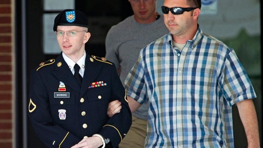June 25, 2013. Army Pfc. Bradley Manning, left, is escorted out of a courthouse in Fort Meade, Md. A military judge is weighing the admissibility of three pieces of evidence suggesting Manning took his cues from WikiLeaks in disclosing classified information.