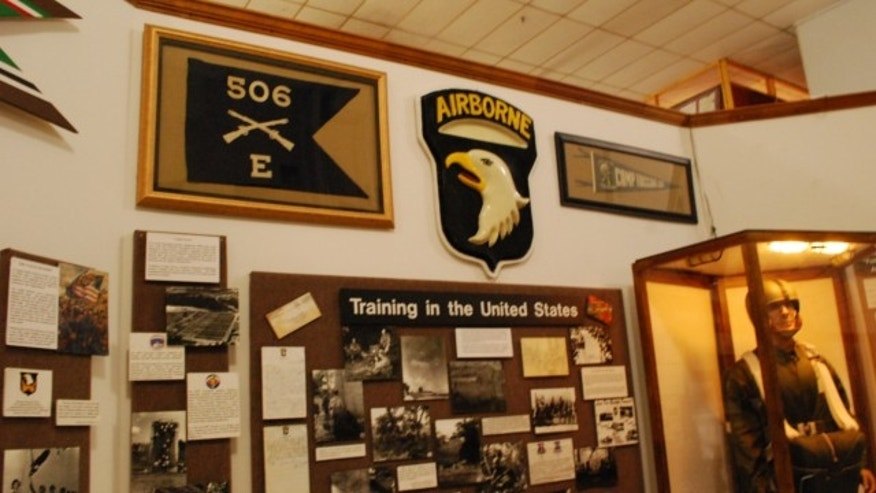 "June 27, 2013: The flag of Easy Company, 506th Parachute Infantry Regiment, who were made famous as the ""Band of Brothers"" in World War II, is seen on a wall inside the museum at Fort Campbell, Ky."