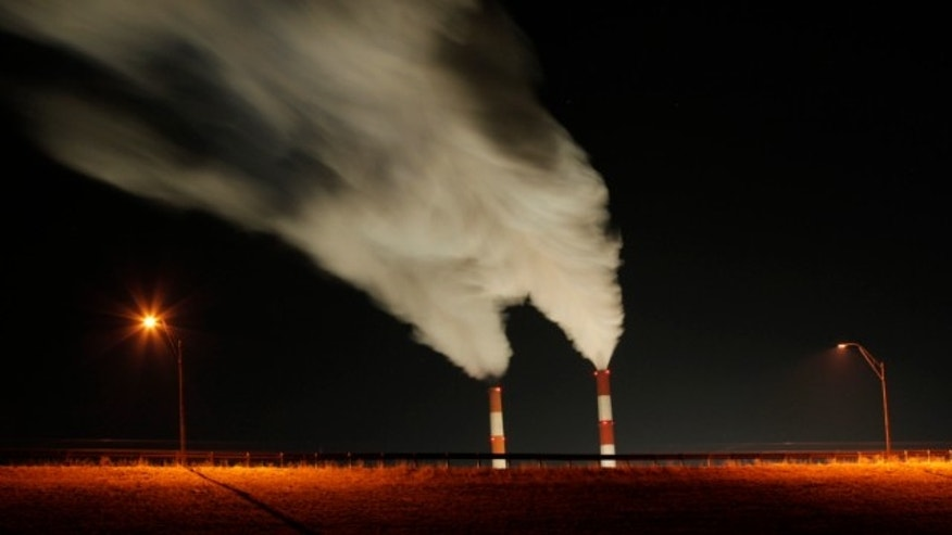 Jan. 19, 2012: This time exposure image smoke rises from the stacks of the La Cygne Generating Station coal-fired power plant in La Cygne, Kan.