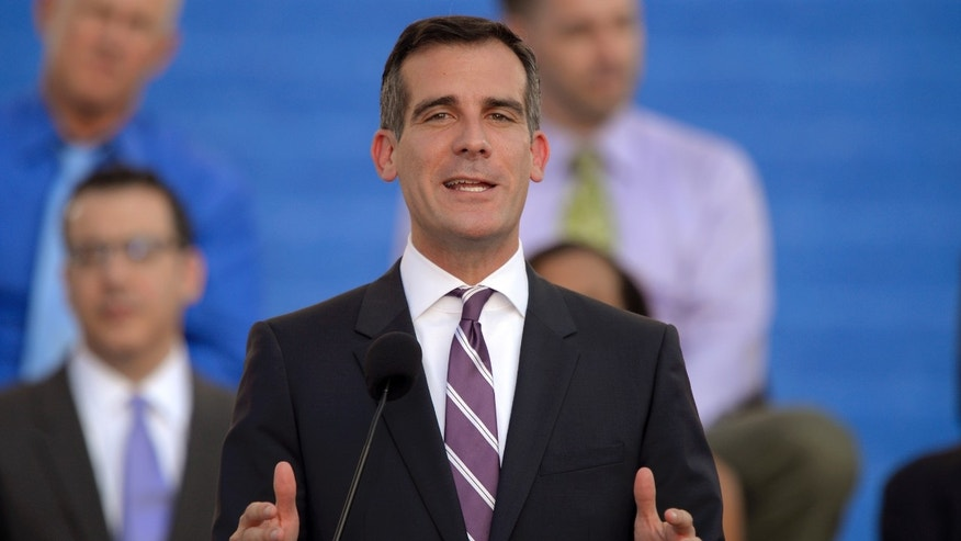 Los Angeles Mayor Eric Garcetti speaks in front of city hall after being sworn in, Sunday, June 30, 2013, in Los Angeles. (AP Photo/Mark J. Terrill)