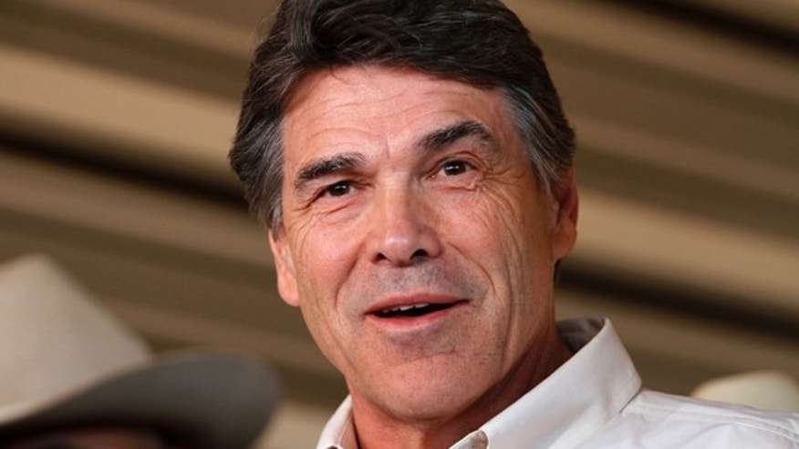 April 19, 2013: Texas Governor Rick Perry answers questions from the media.