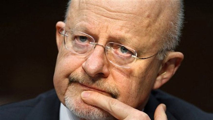 FILE: Jan. 31, 2012: Director of National Intelligence James Clapper listens to a question while testifying on Capitol Hill in Washington, D.C.