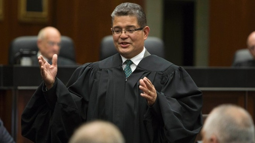 Ruben Castillo gives concluding remarks after being sworn in as chief judge of the U.S. District Court Northern District of Illinois in Chicago, Tuesday, July 2, 2013. Castillo is the first Hispanic to become chief judge of the district. He had been a U.S. district court judge for 19 years. (AP Photo/Scott Eisen)