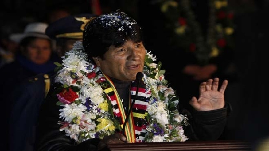 July 3, 2013: Bolivia's President Evo Morales speaks upon his arrival home after an unplanned 14-hour layover in Vienna, at the airport in El Alto, Bolivia. The European rerouting of the Bolivian presidential plane over suspicions that National Security Agency leaker Edward Snowden was aboard ignited outrage Wednesday among Latin American leaders who called it a stunning violation of national sovereignty and disrespect for the region.