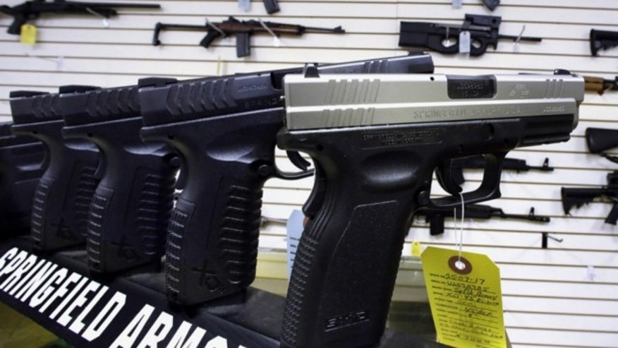 Jan. 16, 2013: Semi-automatic handguns are seen on display at Capitol City Arms Supply in Springfield, Ill.