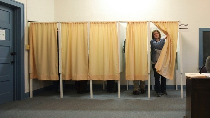 FILE: Nov. 6, 2012: A voter finishes casting her ballot during the presidential elections, in Cannon Falls, Minnesota.