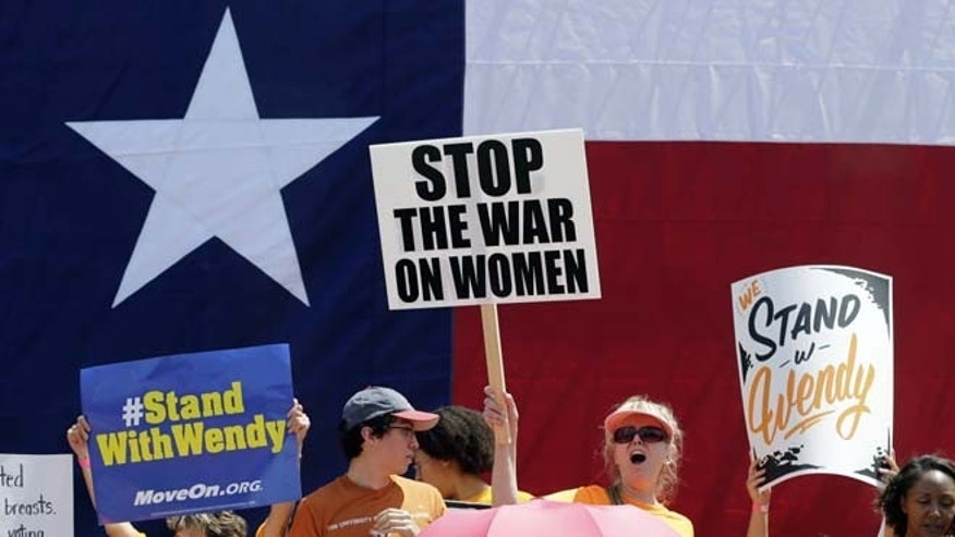 July 1, 2013: Pro-abortion rights supporters cheer during a rally outside the Texas capitol in Austin.