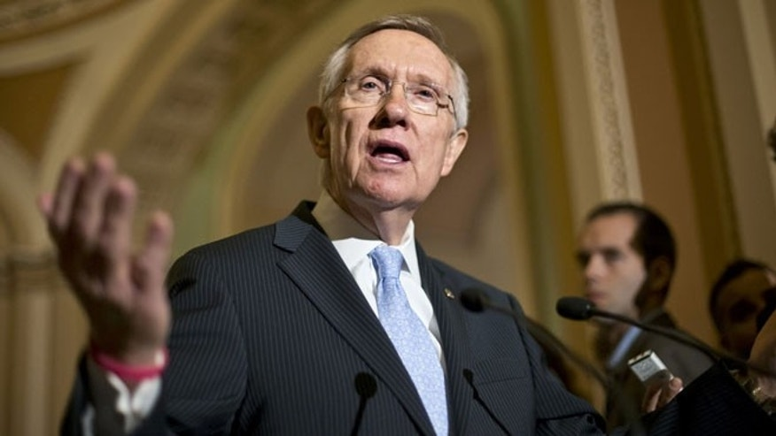 July 9, 2013: Senate Majority Leader Harry Reid of Nev. gestures as he speaks with reporters on Capitol in Washington about student loan rates following a Democratic strategy session. Reid scheduled a procedural vote for Wednesday on a bill restoring the interest rate on subsidized Stafford loans to 3.4 percent for one year. Interest rates doubled to 6.8 percent last week because Congress didn't avert a rate hike built into the law.
