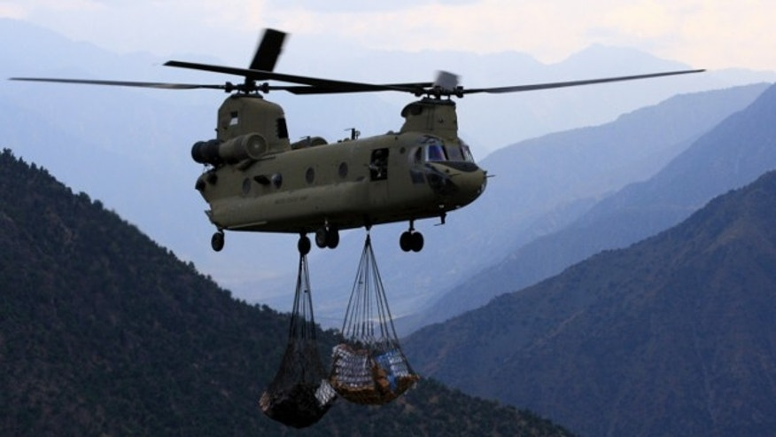 August 26, 2011: An U.S. Army Chinook helicopter carrying supplies prepare to land at Observation Post Mace in eastern Afghanistan Naray district.