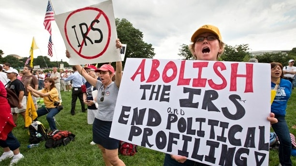 Tea party activists attend a rally on the grounds of the U.S. Capitol in Washington, Wednesday, June 19, 2013. The IRS has been under fire from Democrats and Republicans in Congress since May, when one of its officials publicly apologized for targeting conservative groups' applications for tax-exempt status for close examination. (AP Photo/J. Scott Applewhite)