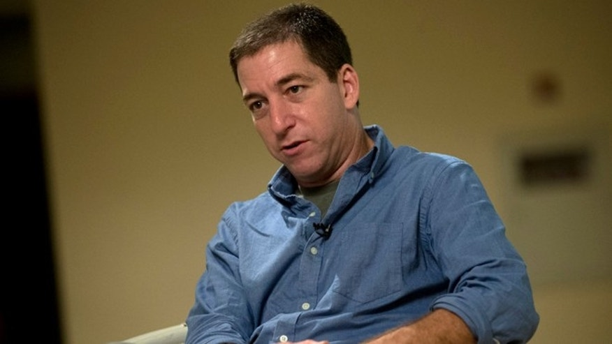 July 14, 2013: Journalist Glenn Greenwald speaks during an interview with the Associated Press in Rio de Janeiro, Brazil.  Greenwald, The Guardian journalist who first reported Edward Snowden's disclosures of U.S. surveillance programs says the former National Security Agency analyst has 'very specific blueprints of how the NSA do what they do.' (AP/Silvia Izquierdo)
