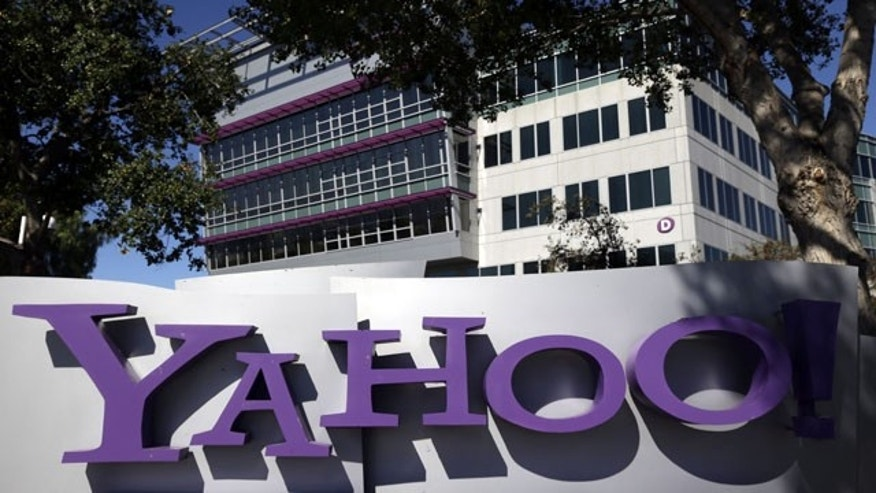 This Wednesday, Oct. 17, 2012 file photo, shows a sign in front of Yahoo! headquarters in Sunnyvale, Calif. (AP Photo/Marcio Jose Sanchez, File)