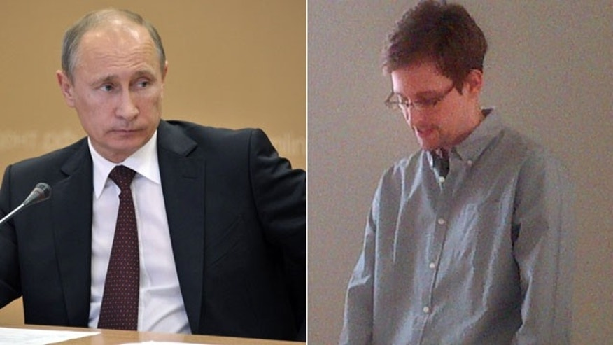 Russian President Vladimir Putin and NSA Leaker Edward Snowden (AP/ Human Rights Watch)