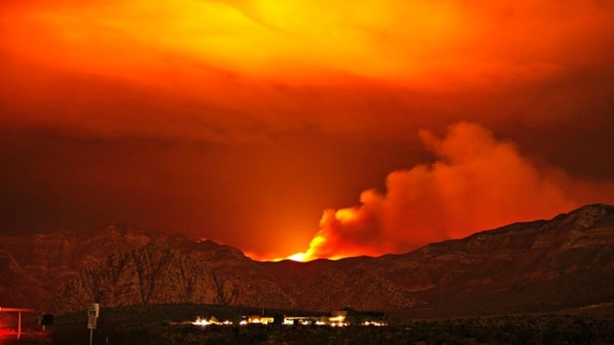 July 11, 2013: The Carpenter 1 fire burns in the mountains behind the Red Rock Conservation Area visitor center near Las Vegas.