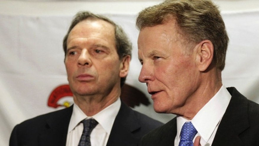 In this June 10, 2013 file photo, Illinois House Speaker Michael Madigan, with Senate President John Cullerton looking on at left, speaks to reporters after a meeting with Gov. Pat Quinn in Chicago.