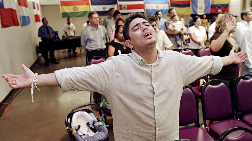 Charlie Anaya, of Phoenix, prays during the worship service at Iglesia Palabra de Vida April 9, 2006 in Mesa, Arizona. There are approximately 300 evangelical Hispanic churches with 15,000 members in the Phoenix area that have been instrumental in organizing for immigrants rights.