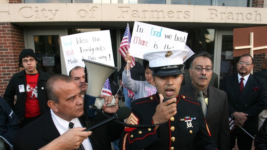Former Marine Sgt. Salvador Parada speaks to protesters during a 2006 rally outside city hall in Farmers Branch, Texas.