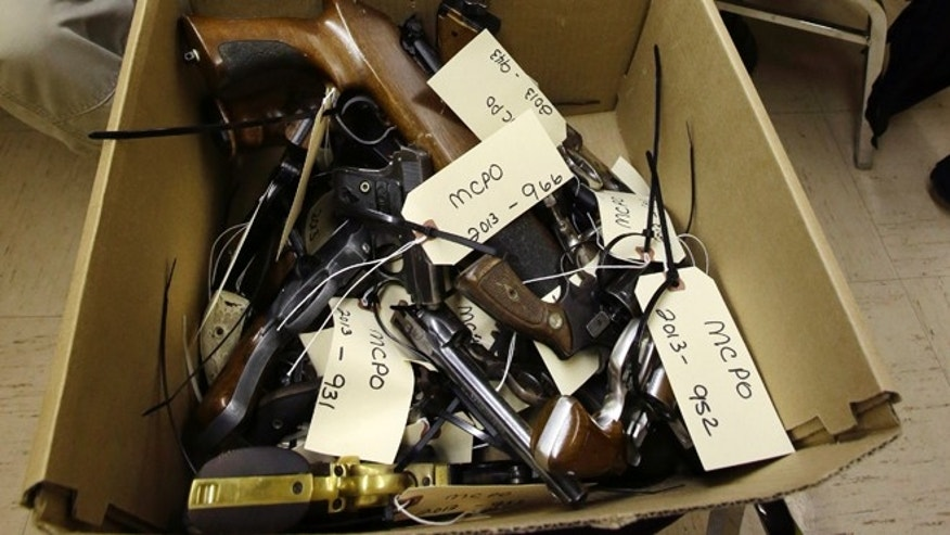 Jan. 26, 2013: Hand guns are seen in a box in Trenton, N.J., during a gun buyback event.
