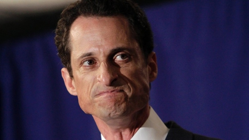 "U.S. Rep. Anthony Weiner, D-N.Y., reacts during a news conference in New York,  Monday, June 6, 2011. After days of denials, a choked-up New York Democratic Rep. Anthony Weiner confessed Monday that he tweeted a bulging-underpants photo of himself to a young woman and admitted to ""inappropriate"" exchanges with six women before and after getting married. (AP Photo/Richard Drew)"
