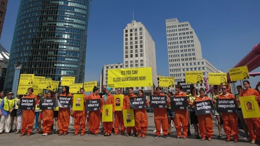 June 19, 2013: Activists of Amnesty International stage a protest in Berlin's Potsdamer Platz against U.S. military prison at Guantanamo Bay during U.S. President Barack Obama's visit to Berlin.
