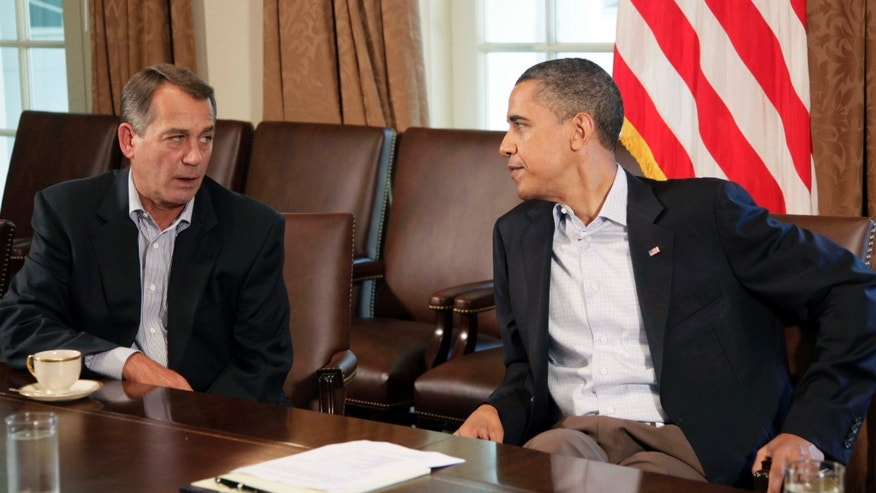 FILE: July 23, 2011: President Obama and House Speaker John Boehner.